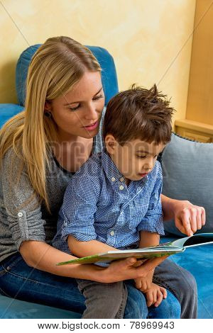 mother and son reading a book, symbol of maternal love, happiness, family, learning