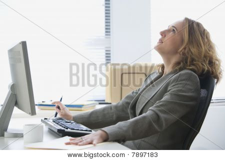 Upset Businesswoman Working in Office