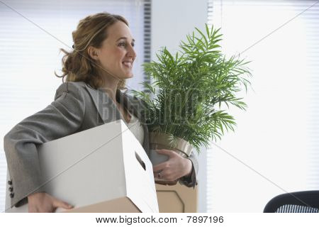 Businesswoman Moves Her Belongings