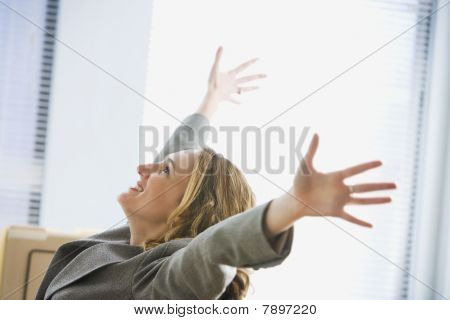 Excited Businesswoman Sitting in Office