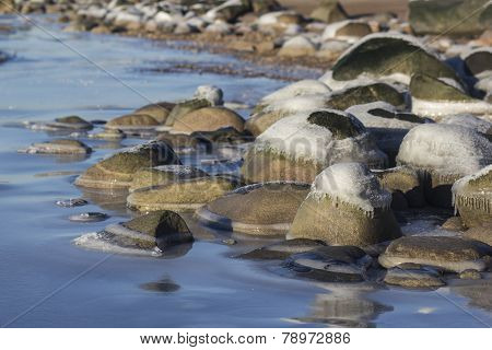 ice-covered rocks on the shore of the Baltic Sea
