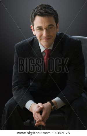 Handsome Businessman Sitting Down