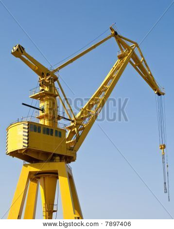 Yellow Harbour Crane On A Sunny Day
