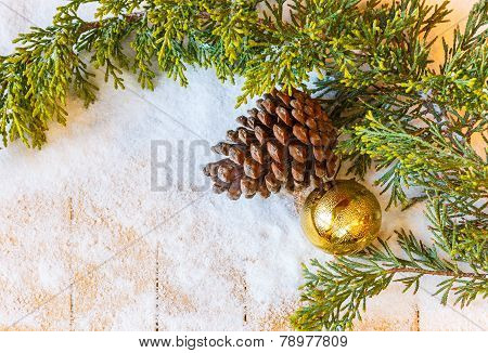 Christmas Tree Branch, Pine Cones And Fir-tree Toy In The Snow