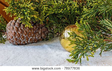 Christmas Decorations, Pine Cones And Christmas Tree Branch In The Snow