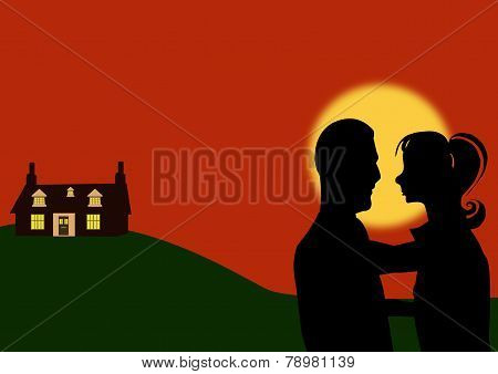 Young Couple And Home At Sunset