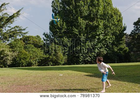 Boy Throws Model Glider