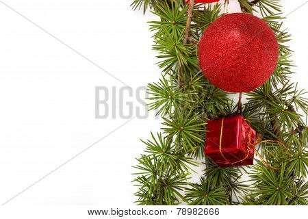 Christmas Decoration With Green Pine Or Fir And Red Round Ornament And One Gift