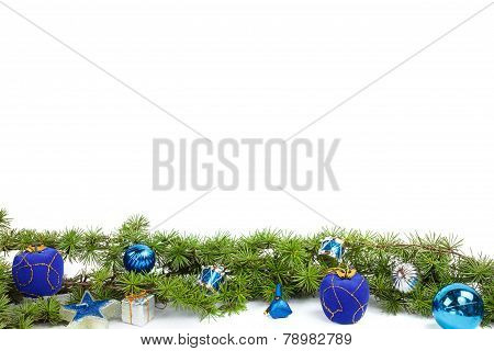 Decoration With Green Pine Or Fir And Blue Round Ornaments And Gifts