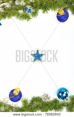 Decoration With Green Pine Or Fir And Blue Round Ornaments One Gift And Candle Star