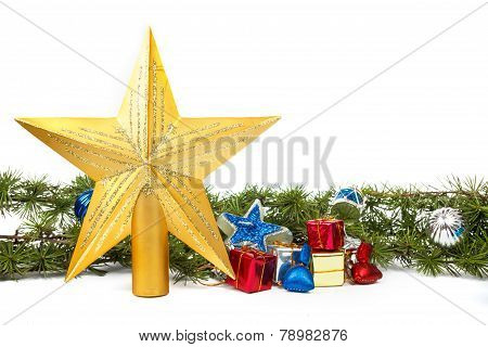 Decoration With Green Pine Or Fir And Many Gifts And Gold Star For Christmas