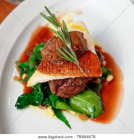 Tenderloin steak with beef terrine and spinach on plate