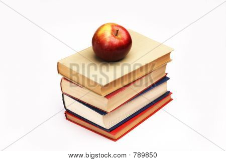 Pile of books and apple