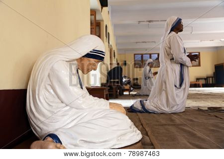 KOLKATA, INDIA - FEBRUARY 08: The statue of Mother Teresa in the chapel of the Mother House, Kolkata, India at 8 February 2014. The statue was made in the pose in which the Mother prayed.
