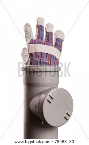 Building glove in soil-pipe on white