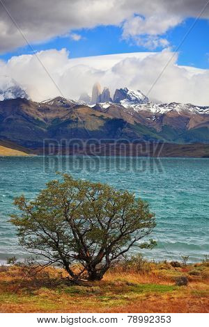 The gale on the Emerald Lake. Thundercloud closes the sky. In the distance the mountains with snow-capped