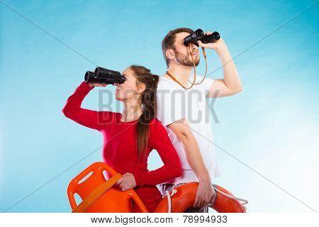 Lifeguards On Duty Looking Through Binoculars