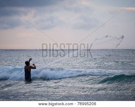 Fisherman on the beach of Kuta in Bali Indonesia