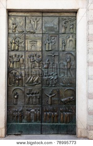 KOTOR, MONTENEGRO - JUNE 10, 2012: The doors of the church of St. Mary, depicting the life of Blessed Osanna of Cattaro in Kotor, Montenegro, on June 10, 2012