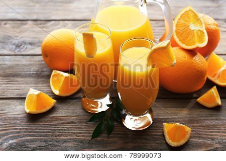 Freshly squeezed orange juice on wooden table