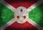 foto of burundi  - Old rusty metal sign with a flag  - JPG
