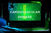 stock photo of coronary arteries  - Notebook with words  cardiovascular disease  - JPG