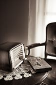 pic of doilies  - Vintage radio on round table with doily and living room on background - JPG