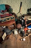 picture of attic  - Group of vintage assorted items on attic hardwood floor with vintage wallpaper background - JPG