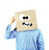 foto of incognito  - Man with cardboard box on his head isolated on white - JPG