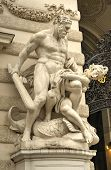stock photo of hercules  - Statue of Hercules outside the Hofburg Palace in Vienna Austria showing how he fulfills the legendary Labors of Hercules - JPG