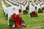 stock photo of arlington cemetery  - Gravestones with Christmas wreaths in Arlington National Cemetery  - JPG