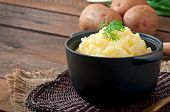 stock photo of mashed potatoes  - Fresh and flavorful mashed potatoes with wooden table - JPG
