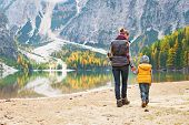 image of south tyrol  - Mother and baby walking on lake braies in south tyrol italy - JPG