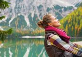 image of south tyrol  - Portrait of relaxed young woman on lake braies in south tyrol italy - JPG