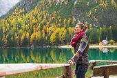 picture of south tyrol  - Relaxed young woman on lake braies in south tyrol italy - JPG