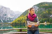 image of south tyrol  - Young woman with map on lake braies in south tyrol italy - JPG