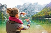 pic of south tyrol  - Young woman on lake braies in south tyrol italy framing with hands - JPG