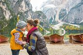 foto of south tyrol  - Portrait of mother and baby on lake braies in south tyrol italy - JPG
