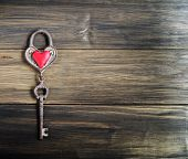 pic of key  - Heart and key on wooden background Valentine - JPG