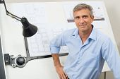 image of blueprints  - Portrait Of Male Architect With Blueprint At Office - JPG