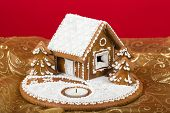 stock photo of gingerbread house  - Holiday Gingerbread house on red background christmas cookie - JPG