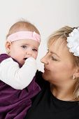picture of new years baby  - mother with her cute little baby girl first year of the new life - JPG