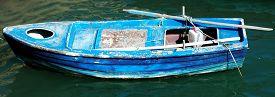 picture of sloop  - Old fisherman boat on the green waters of Heraklion port - JPG