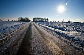 stock photo of unsafe  - Black ice in a winter time on a sunny day  - JPG