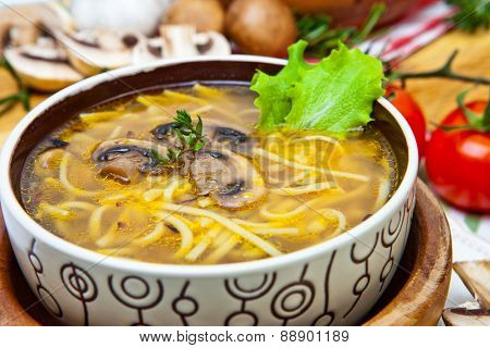 Soup with noodles and mushrooms
