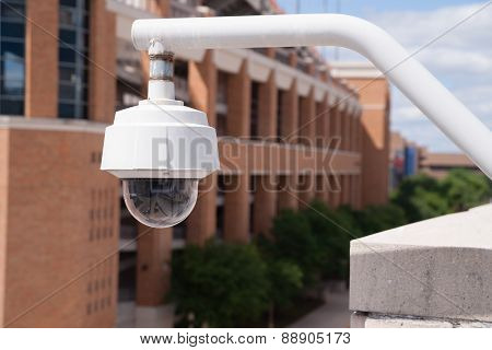 Video Security Camera Housing Mounted High On College Campus
