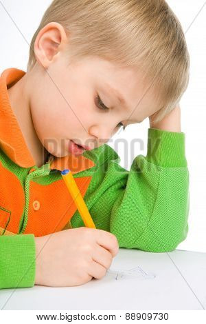 Cute 6 Years Boy Drawing His Mum Diligently