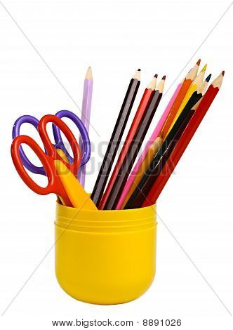Some Scissors And Pencils In A Cup