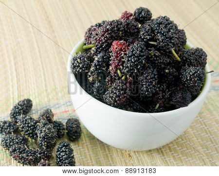 Fresh Mulberry In Bowl On Straw Mat