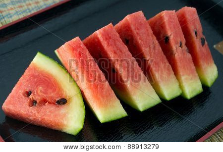 Sliced Of Fresh Watermelon On A Black Tray